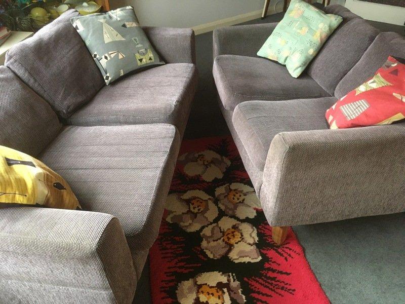 A pair of comfy retro style sofas