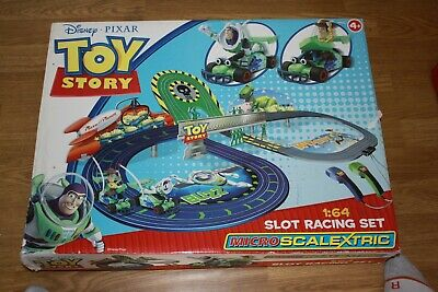 Diney Pixar Toy Story MicroScalextri c Slot Racing Car Set
