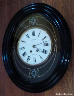 Antiguo reloj ojo de buey, movimiento Paris, funcionando