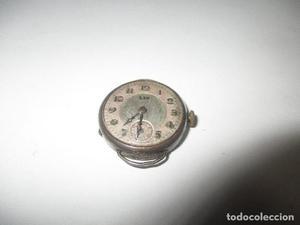 antiguo reloj de señora funcionando de plata