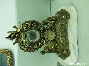 bonito reloj de bronce con peana de marmol