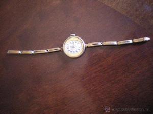 reloj de señora con cadena extensible,dorado y marca FLEURY