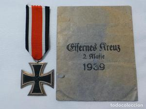 Lote formado por una preciosa cruz de hierro, marcaje 65 y