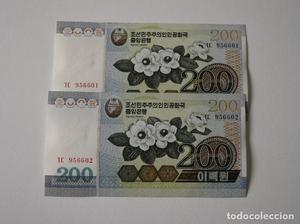 2 BILLETES KOREA 200 WON - Sacados de taco. Numeración