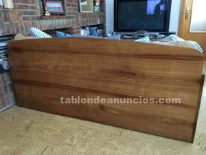 Sofá cama en madera preciosa sólida.