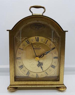 Reloj de bronce RADIANT TEMPUS FUGIT.