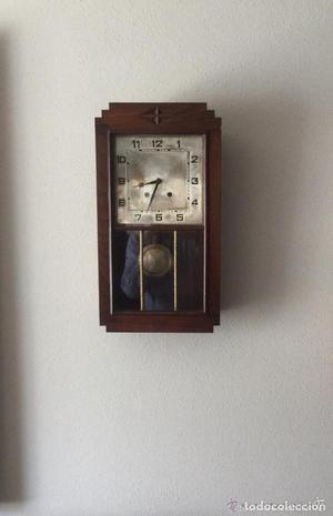 Reloj de pared maquinaria a cuerda caja en madera de roble