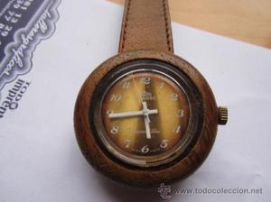 raro reloj de pulsera de madera y plexi