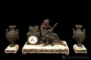 reloj bronce con guarnicion