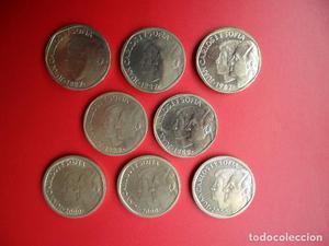 8 monedas de 500 pesetas  y