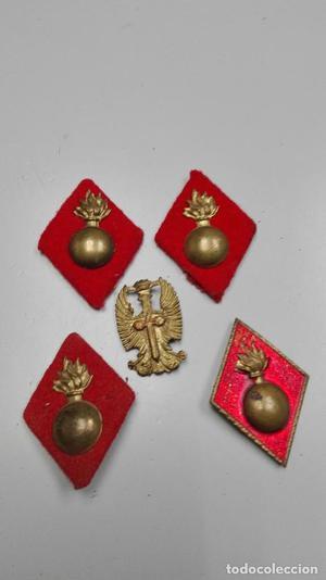 Lote insignias. Águila de san Juan y artillería