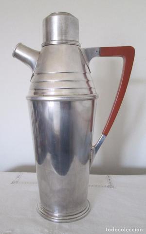 Antigua jarra licorera en metal plateado y asa en baquelita