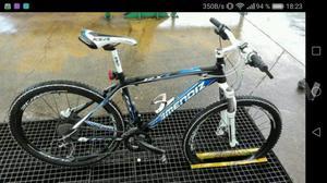 Bicicleta de montaña + bici de descenso.