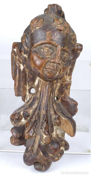 Fragmento de cabeza de ángel en madera de nogal siglo XVII