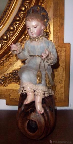 Niño Jesús en madera tallada y policromada. Primer tercio