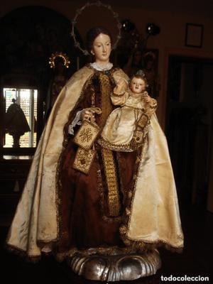 Virgen del Carmen con niño. Talla capipota. Coronas de