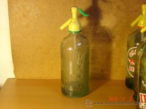Sifon: Botella labrada identificada en la base Olcina y