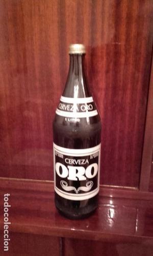 botella vacia cerveza oro