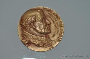 medalla de bronce dorado de calico, miquel j. serra,