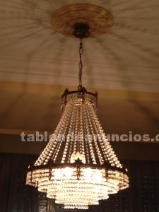 Se venden lamparas de bronce y cristal