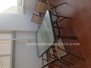 Vendo mesa de jardín de aluminio negro con cuatro sillas