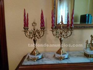 Candelabros en bronce de cuatro brazos