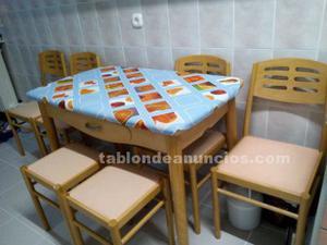 Mesa de cocina con dos bancos y cuatro sillas