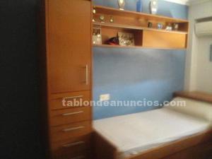Dormitorio juvenil en madera de nogal