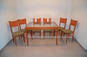 6 sillas y una mesa de cristal para comedor