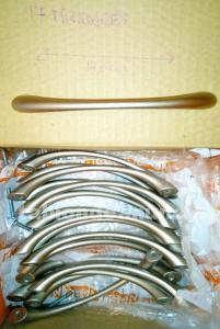 Tiradores de níquel con acabado en dorado