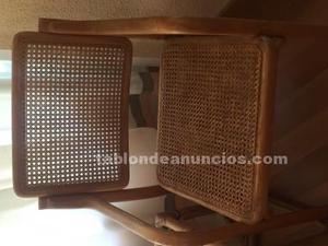 Cuatro sillones de rejilla