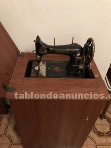Máquina de coser antigua, marca brage, con mueble.