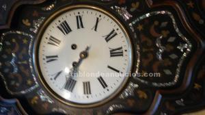 Reloj de pared, ojo de buey