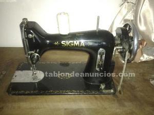 Máquinas antiguas de coser en perfecto estado dos máquinas