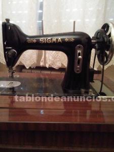 Vendo máquina de coser antigua marca sigma con mueble