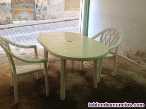 Mesa ovalada para terraza y dos sillones