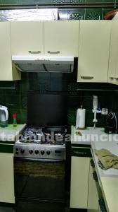 Cocina de gas con electrodomésticos