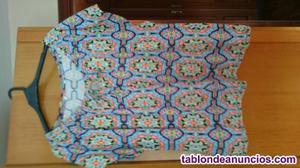 Blusa con elasticos en la parte de arriba talla