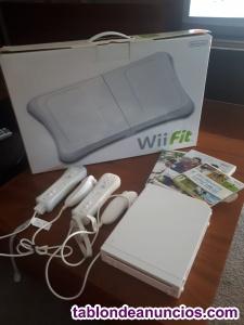 Vendo consola wii + 2 mandos + tabla wii fit +3 juegos