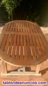 Se vende mesa + regalo 10 sillas + sombrilla grande