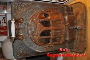 se vende estufa Salamandra en buen estado, siglo XVIII.