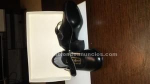 Zapatos y botas sin usar muy muy baratos