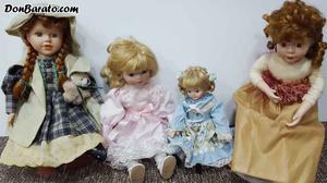 4 muñecas de porcelana