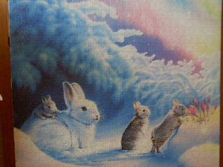 Puzzle de conejos comiendo en el campo