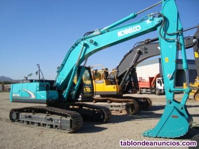 Retro excavadora giratoria de cadenas kobelco sk210 lc