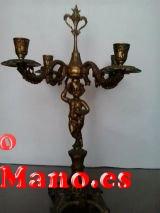Vendo pareja de candelabros de bronce con cuatro brazos