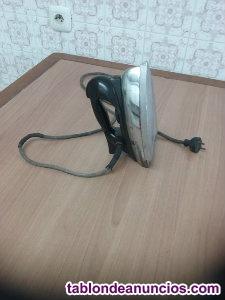 Plancha electrica marca jata de 23 cms. De larga y 12 cms.de