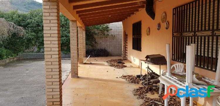 Casa con terreno cultivo