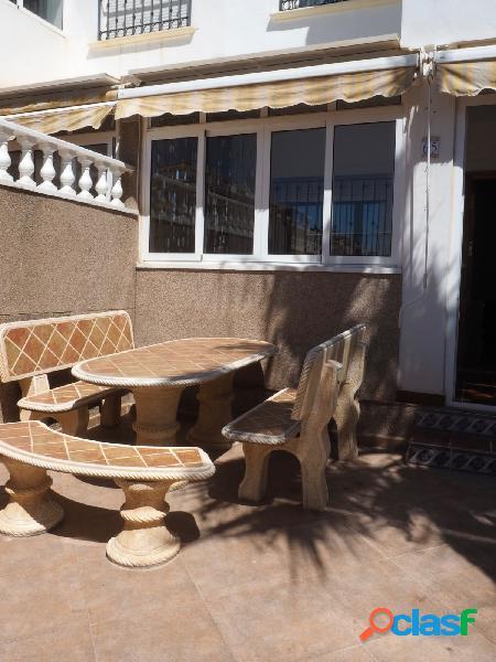 Bungalow en planta baja, 2 dormitorios, piscina comunitaria,