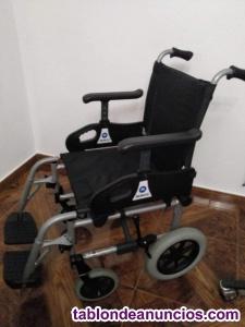 Cama elevadora, grua y silla de ruedas